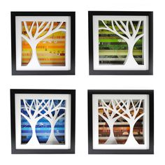 """Four Seasons Shadowboxes (by Amy Gibson) (1/4) - four intricately hand-cut trees against collages of seasonal color, made from discarded pages. Each shadowbox is 10"""" x 10""""."""