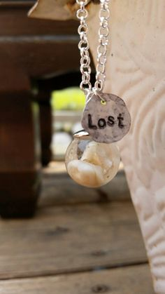 Check out this item in my Etsy shop https://www.etsy.com/listing/246380572/real-teethtooth-sphere-necklace-lost