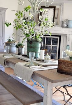 there isn't anything I don't love on this page; the galvanized bucket with flowers the wood box and shutter on the table...down home country simple