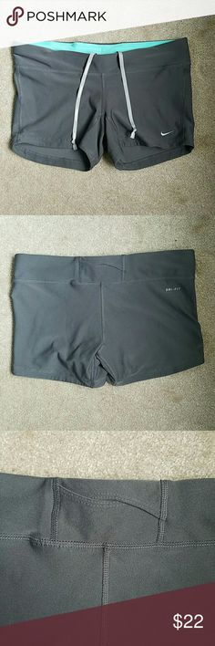 Nike Dri-FIT Running Shorts Grey with aqua inside band lining. Small pocket on band in back. 92% polyester 8% spandex. Great pre-loved condition!   ???????? DO NOT ask me to trade  DO NOT ask me my lowest  REASONABLE offers considered but ONLY using the offer Nike Shorts
