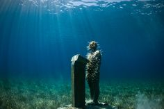 The Listener, Depth 4m, MUSA Collection, Punta Nizuc, Mexico. - Underwater Sculpture by Jason deCaires Taylor