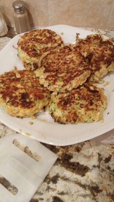 Home made tofu burgers! (Tofu, zucchini, carrots, celery, bread crumbs, eggs, and peppers!