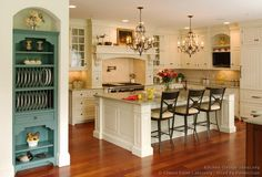 Love the teal/blue shelf and multi height island and wide plank floors