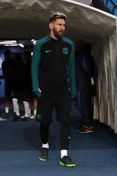 Lionel Messi of Barcelona walks out during a training session ahead of the UEFA Champions League match between Manchester City and Barcelona at the City Football Academy  on October 31, 2016 in Manchester, England.