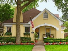 This adorable yellow home with open front porch is how Dallas, TX does #curbappeal. #hgtvmagazine http://www.hgtv.com/design/outdoor-design/landscaping-and-hardscaping/copy-the-curb-appeal-dallas-tx-pictures?soc=pinterest