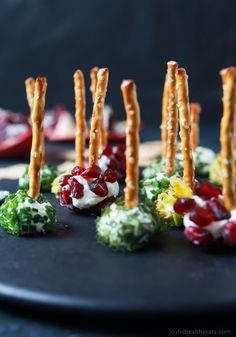 Everyone loves a good cheese ball, but your guest will fall in love with these Assorted Holiday Goat Cheese Balls coated with a combination of fresh dill, chives, pistachios, and pomegranate seeds!   joyfulhealthyeats.com #appetizer #ad #holiday