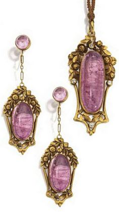 Gold and pink tourmaline pendant-necklace and earrings, Marsh's, circa 1920. The pendant set with a large oblong-shaped pink tourmaline cabochon within a gold frame decorated with roses and leaves and set with 4 old European-cut diamonds, the matching earrings set with 2 oval-shaped pink tourmaline cabochon within frames of similar design, the tops with round pink tourmaline cabochons, earrings signed Marsh's. #Marsh's #vintage #necklace #earrings