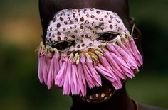 Surma and Mursi people of Ethiopia. Hans Silvester photograph.