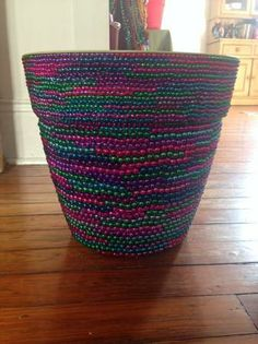 Use all those old Mardi Gras beads to spruce up plant pots! Genius! Now I know what to do with the thousands we end up with every year!