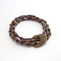 Seed Bead Bracelet, Multi Strand Stacking Bracelet,  Purple Green Metallic, Bohemian Style Jewelry. $34.00, via Etsy.