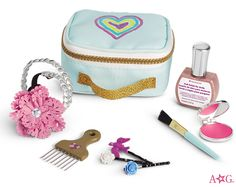 Gabriela's Showtime Kit. This set helps Gabriela get ready backstage. Includes:  A vibrant case with a heart graphic and carrying strap • A compact with pretend makeup and mirror, a bristle brush, and a golden hair pick • A braided metallic headband and a flower hairband with a pretend gem in the center for added flair • A hair pin set with flower and bird embellishments • Real doll nail polish in an exclusive metallic shade that will wash off with water $34