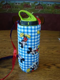I have been wanting to make my kids water bottle carriers for a while. I  saw a great tutorial for one a while back that was insulated with . dca036241f33f