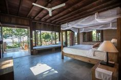 Mango Bay Resort Phu Quoc offers various accommodation: bungalows, villas, rooms for families, couples or friends willing to enjoy the nature and beach view. Gazebo, Pergola, Outdoor Furniture, Outdoor Decor, Southeast Asia, Bungalow, Vietnam, House Plans, Outdoor Structures