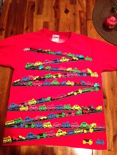 Celebrating 100 days of school with 100 cars on a shirt. Think- fabric glue!