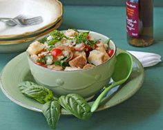 Panzanella  --good honest recipe added fresh oregano sprig and bay leaf, garlic salt instead in dressing, chopped parsley. used 1/3 cup oil 2 T vinegar.  served fresh basil and parm over each serving. Try using lemon juice instead of vinegar.