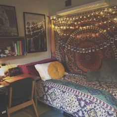 Here, I love the shelves, and the poster placement, also I love the lights and the two patterns you will receive with the comforter being a separate print from the tapestry. The Polaroids draped across the tapestry is also a very cute and eclectic look.