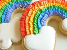 Rainbow Cookie Tutorial <3 Because it's the season of leprechauns and pots o' gold, I'm reposting a tutorial for rainbow cookies! Yes they look fancy, but they really are a snap! Hope you give them a try! It's officially rainbow season!