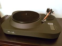 An intriguing newly manufactured double-pulley belt-driven turntable... Love the chassis and platter. Made in L...