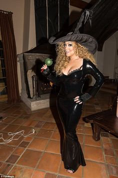 That was then: Last year she opted once again for latex - although her character of choice was a sexy witch with a lace trimmed bra and a staggering hat