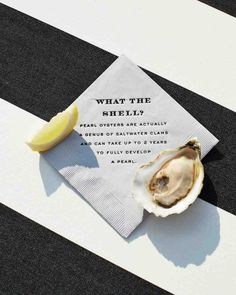 "23 Cute Wedding Coasters & Napkins | Martha Stewart Weddings - Raw-bar napkins at this wedding were chic and tongue-in-cheek. A second napkin read ""What the Shuck?"""