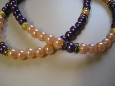 Purple,Peach Pearls,Gold sugar coated spacer beads,Rondells, Gold with Purple Crystals lined gold.                                    1