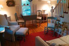 A living room with original hardwood floors.