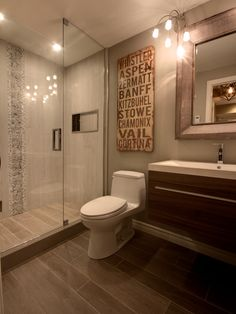 What's the difference between designing a basement bathroom vs. any other bathroom? Check out the latest basement bathroom ideas today! Basement bathroom, Basement bathroom ideas and Small bathroom. Bathroom Tile Designs, Bathroom Renos, Bathroom Cabinets, Bathroom Layout, Bathroom Furniture, Bad Inspiration, Bathroom Inspiration, Wood Ceramic Tiles, Basement Bedrooms