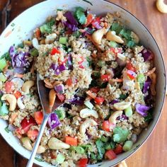 This crunchy cashew Thai quinoa salad with ginger dressing is filled with healthy goodness: carrots, cabbage, quinoa, cilantro, cashews, and more!