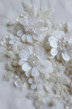 Hand-made wedding motif with pearls, twinkling balls of glass beads and petals wrapped in silk organza Bead Embroidery Patterns, Beaded Embroidery, Embroidery Designs, Embroidery Stitches, Beaded Flowers, Fabric Flowers, Wedding Motifs, Lesage, Silk Organza