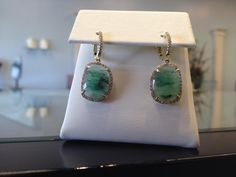 Mmmmm, Emerald slice set in 14k Yellow Gold with Diamond Halo.  Treat yourself at Artisan Jewelers in Lafayette!