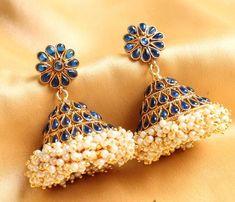 Beautiful! -https://www.cooliyo.com/product/92270/splendid-antique-pearl-cluster-blue-huge-jhumka/