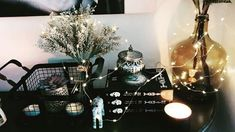 String lights and dark decor are all I need to decorate shelves and console tables. I have to mainta Rustic Industrial Decor, Industrial Style, Black Painted Walls, Bright Paintings, Studio Apartment Decorating, Witch Aesthetic, Rustic Interiors, Fairy Lights, Wall Colors