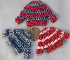 Teeny Tiny Sweater Ornaments - This is a fun Christmas craft project for anyone that likes to crochet. #free #pattern