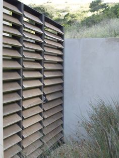 "Louvred privacy screen, to hide pool equipment. Would suit out ""tropical bali"":"