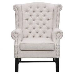 "Bring stately style to your living room or den with this handsome arm chair, showcasing a birch wood frame and nailhead trim.    Product: ChairConstruction Material: Linen, foam and birch woodColor: BeigeFeatures:  Nailhead trimButton-tuftedRemovable seat cushion19.69"" Seat height Dimensions: 42.5"" H x 32.6"" W x 32.6"" DCleaning and Care: Spot clean onlyAssembly: Assembly required, hardware included"