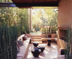 The Brentwood Residence by Studio William Hefner combines modern architecture with outdoor living. To reduce the size of the proposed 8,000 square foot structure, they chose to take some of the entertainment areas outdoors – a large courtyard that continues the living and dining rooms spaces, a sunken seating area with a fireplace, and a patio on the back of the house that goes the length of the family room and kitchen.