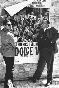 Marcello Mastroianni and Federico Fellini pose by a poster for La Dolce Vita (1960)