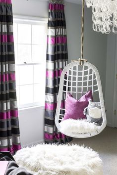 Purple and gray stripe curtains.