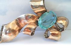 Vintage Retro Sterling Silver Bow Brooch With Aqua Marine Stone and Rhinestones Vintage 1940s Jewelry Retro Jewelry by NowAndThenShop on Etsy https://www.etsy.com/listing/176563144/vintage-retro-sterling-silver-bow-brooch