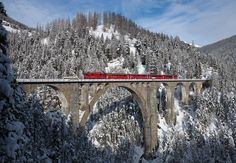 A RhB Ge 4/4 II with a push–pull train crosses the Wiesen Viaduct between Wiesen and Filisur, Switzerland. Click on this image and on the next two images for a real up-close look.