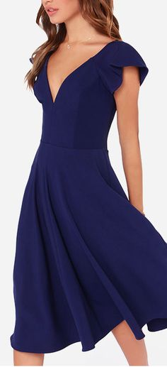 navy midi dress; gorgeous bridesmaids idea, with a little less cleavage