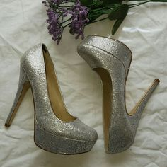 Sparkly Aldo Platform Heels Great for prom! Super fun and sexy. 5in heel with 1.25in platform. A bit of wear to the top ankle part (see pic 4) Genuine leather.  Reasonable offers welcomed. No low balling offers please. Willing to negotiate ?? ALDO Shoes Heels