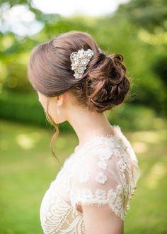 low bridal updo, photo by Wedding Belles http://ruffledblog.com/english-countryside-wedding-inspiration #weddinghair #hair