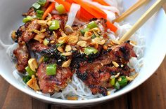 Thit Nuong - Vietnamese Grilled Pork Bowl. Usually has carrots, jicama, peanuts, cuke, lettuce, roasted peanuts, grilled lemongrass pork, grilled green onions and vermicelli with a side of nouc mam. Total favorite!!