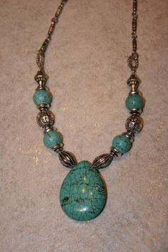 Turquoise necklace, would be pretty done with gold or copper.