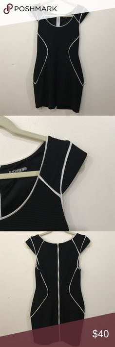 Express Black and White Body Con Dress Comfortable, stretchy body con dress. Black with white detailing. Very flattering. Lands slightly above mid-thigh. Zipper all the way down the back. Can be worn to work or formally. Wore once to a wedding and it is in near perfect condition. Express Dresses Strapless