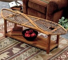 We come across these vintage snow shoes occasionally. What a creative idea to use them as a table. DIY snow shoe small table. <3
