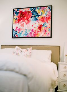 Bright abstract colors make this bedroom pop
