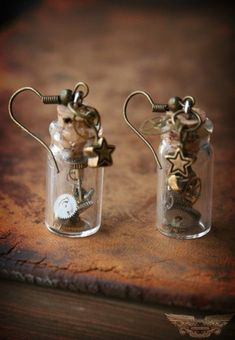 Time in a Bottle Steampunk Earrings. Add tea charms for tea themed costume Bottle Jewelry, Bottle Charms, Diy Jewelry, Jewelery, Jewelry Design, Jewelry Making, Bullet Jewelry, Skull Jewelry, Jewelry Necklaces