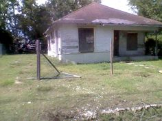 Bungalow home needs some tlc review and submit an offer. Fenced in but torn needs some reconstruction boarded up